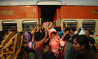 Women try to enter the ladies' compartment of a crowded train heading towards Delhi