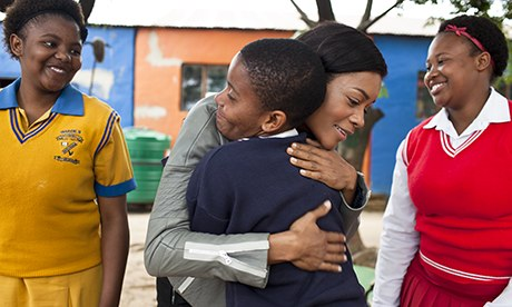 Naomie Harris visits Save the Children's Hlayisanani Day Care Centre in the informal settlement of S
