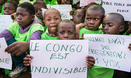Children hold placards during a One Billion Rising rally, in Bukavu, Congo
