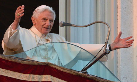 Pope Benedict XVI waves to the faithful from a balcony at Castel Gandolfo