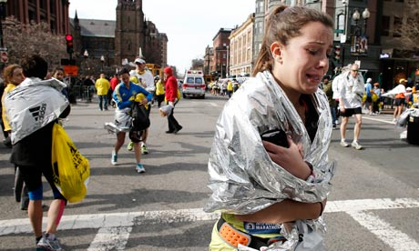 Boston: A Marathon runner leaves the course in tears near Copley Square following an explosion