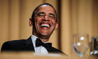 President Barack Obama reacts during the White House Correspondents' Association Dinner 