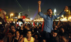 Egyptian protesters react as they watch President Morsi's speech in Cairo