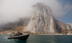 A Gibraltar police boat patrols the water as Spanish fishermen return from their protest in the sea