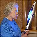 The Queen holds the Commonwealth Games baton
