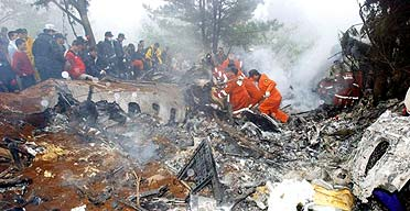 Firefighters search for survivors of an Air China Boeing 767 airplane that crashed in South Korea