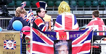 Spectators take their place outside Buckingham palace