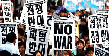 Anti-war protesters march in Seoul, South Korea