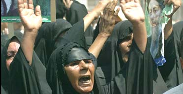Shia Muslim women mourn the death of Ayatollah Mohammed Baqir al-Hakim in Najaf
