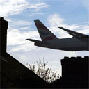 A jet flying low over houses at Heathrow