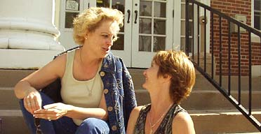 Debbie Roath and Rachel Trueblood await their husbands' return from Iraq