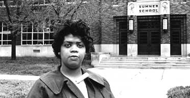 Linda Brown Smith, photographed in 1964 in front of the Summer School in Topeka, Kansas. The school's refusal to admit her in 1951 because she is black led to the Supreme Court ruling outlawing enforced segregation in US schools