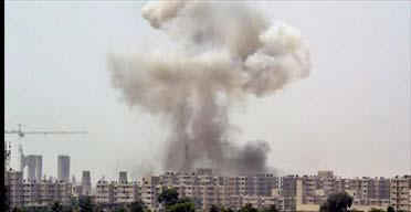 A huge cloud of smoke over central Baghdad. Photograph: Anja Niedringhaus/AP