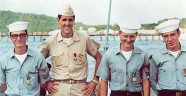 John Kerry in a 1969 photograph pictured with members of his boat crew in the Mekong Delta during the Vietnam war