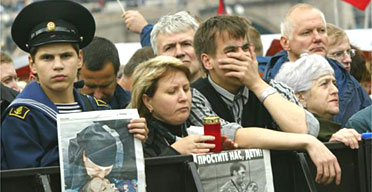 Demonstrators hold Russian newspapers with photos of the hostage crisis in Beslan as they rally against terrorism in downtown Moscow