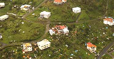Buildings in Grenada lie in ruins after Hurricane Ivan's passage. Photograph: Jack Russell/AP