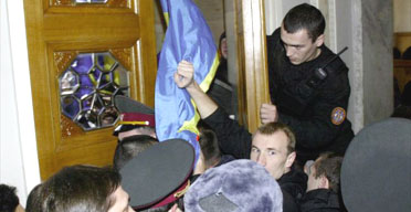 Supporters of Ukrainian opposition leader Viktor Yushchenko try to enter the parliament building in Kiev, after members voted down a no confidence motion in the government of the prime minister,Viktor Yanukovich. Photograph: Genya Savilov/AFP/Getty Image