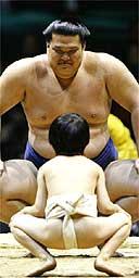 South Korean-born sumo wrestler Kasugao and a young Japanese sumo