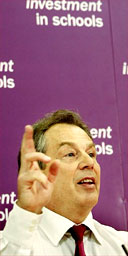 Tony Blair speaks to journalists at a technology school in London. Photograph: Peter Macdiarmid/Getty