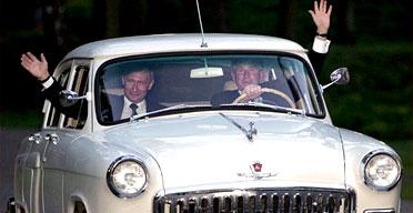 George Bush and Vladimir Putin take a drive in the Russian president's 1956 Volga. Photograph: Tim Sloan/AFP