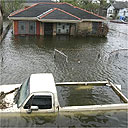 A pickup truck is filled with water on a street in the Ninth Ward of New Orleans, after a storm surge from Hurricane Rita breeched a patch in the levee of the Industrial Canal, reflooding the area
