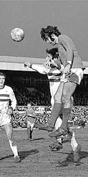 George Best heads in a goal for Manchester United at the 1970 fifth round FA Cup tie at Northampton