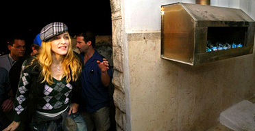 Madonna visits a Kabbalist tomb on a trip to Israel hosted by Shaul Youdkevitch, director of the Kabbalah Centre in Tel Aviv. Photograph: Pedro Ugarte/Getty