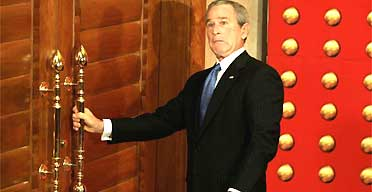 The US president, George Bush, finds the door locked as he attempts to leave a press conference in Beijing. Photograph: Jason Reed/Reuters