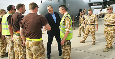 Tony Blair shakes hands with Royal Airforce personnel as he arrives in Basra