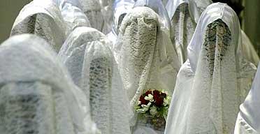 Muslim brides wait for the start of their mass wedding