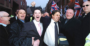 BNP leader Nick Griffin (centre right) and Mark Collett (centre left) leave Leeds crown court