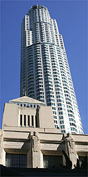The US Bank Tower, formerly known as the Library Tower, is shown behind the central Los Angeles Library in downtown Los Angeles