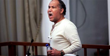Barzan Ibrahim al-Tikriti, half-brother of Saddam Hussein, screams at the judges at the court of the Iraqi high tribunal. Photograph: Chris Hondros/Getty Images