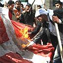 Palestinian students burn a Danish flag