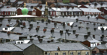 The dome of a mosque is seen rising above terraced houses in Blackburn. Photograph: Christopher Furlong/Getty