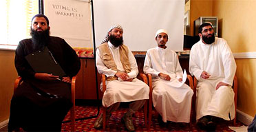 In April 2005, al-Ghurabaa members (left to right) Abdul Muhid, Abu Walled and Abu Baraa held a press conference in a Walthamstow hotel room to urge Muslims not to vote in the general election. Photograph: Martin Godwin