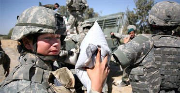 US and Afghan soldiers distributing emergency aid in Pashmul in southern Afghanistan