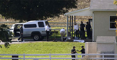 Police are seen outside the Amish school in Pennsylvania where a gunman shot dead three girls before killing himself. Photograph: Matt Rourke/AP