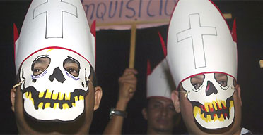 Men dressed as priests take part in a protest in support of therapeutic abortion in front of the National Assemby Building in Managua, Nicaragua