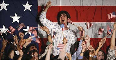 Democrat supporters celebrate the party's victories in the midterm elections