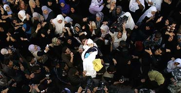 Palestinian mourners carry the body of three-year-old Maysa al-Athamna in Beit Hanoun