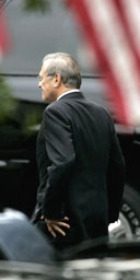 Donald Rumsfeld leaves the White House after announcing his resignation as US defence secretary