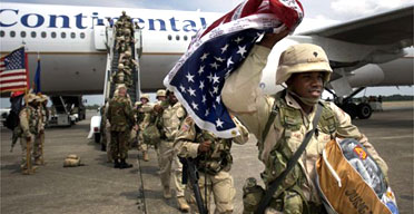 A soldier celebrates as he returns to Georgia after surviving a tour of duty in Iraq. The Iraq Study Group argued against a quick US military withdrawal from the country