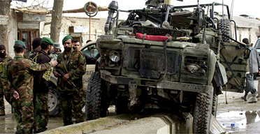 The Nato vehicle hit by a suicide bomb which killed three Afghans and injured three Britons. Photograph: Allauddin Khan/AP