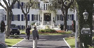 Security guards outside the home of singer Robin Gibb in Miami Beach, Florida