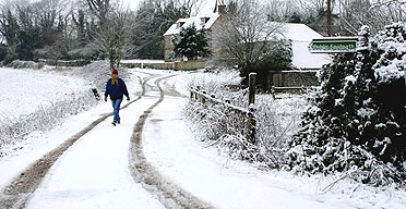 A walker trudges through the snow at Cocking, West Sussex. Photograph: Chris Ison/PA