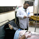 An Iraqi medic treats a victim of a chlorine tanker explosion north of Baghdad