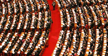 Delegates listen to Wen Jiabao's speech during the opening ceremony of the National People's Congress