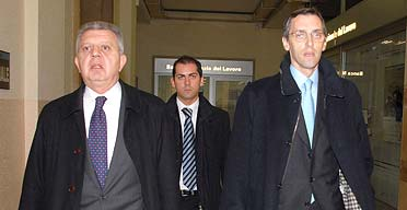 Silvio Berlusconi's lawyers, Pietro Longo (left) and Nicola Ghedini (right) arriving in court for the start of the trial