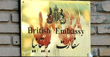 Bloody handprints on the plaque of the British embassy in Tehran